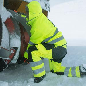 Man working in snow in Helly Hansen rain gear
