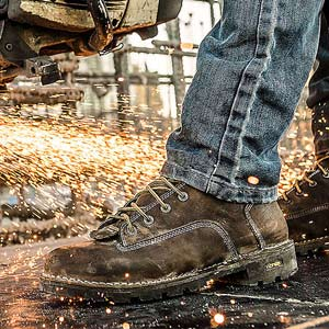 Sparks spraying on to Danner Work Boot