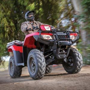 Man riding red Honda ATV