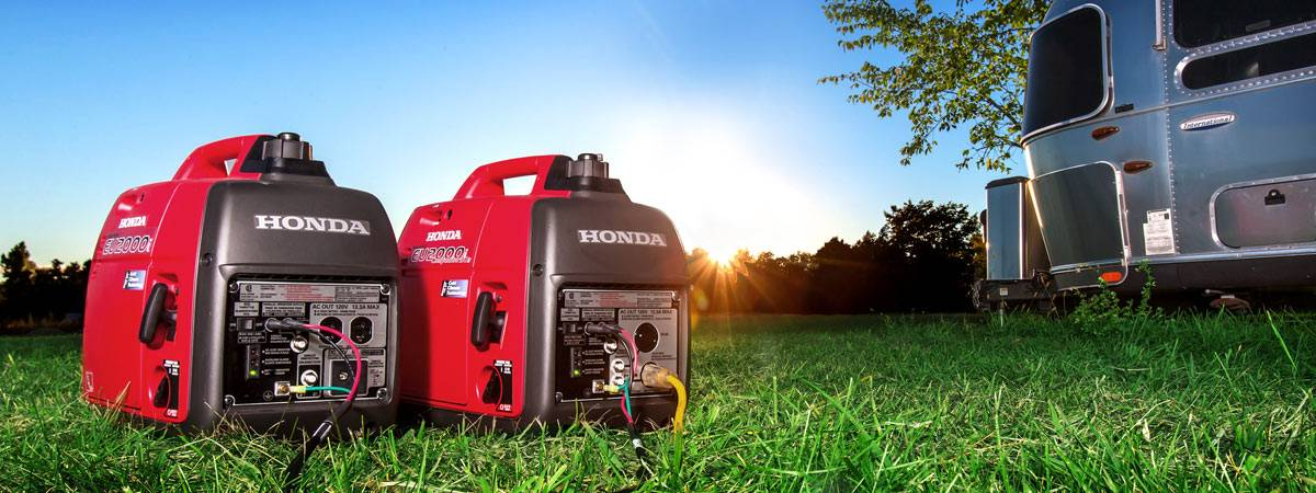 Two Honda generators connected to travel trailer
