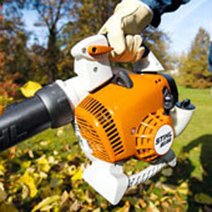 Person blowing leaves with Stihl leaf blower
