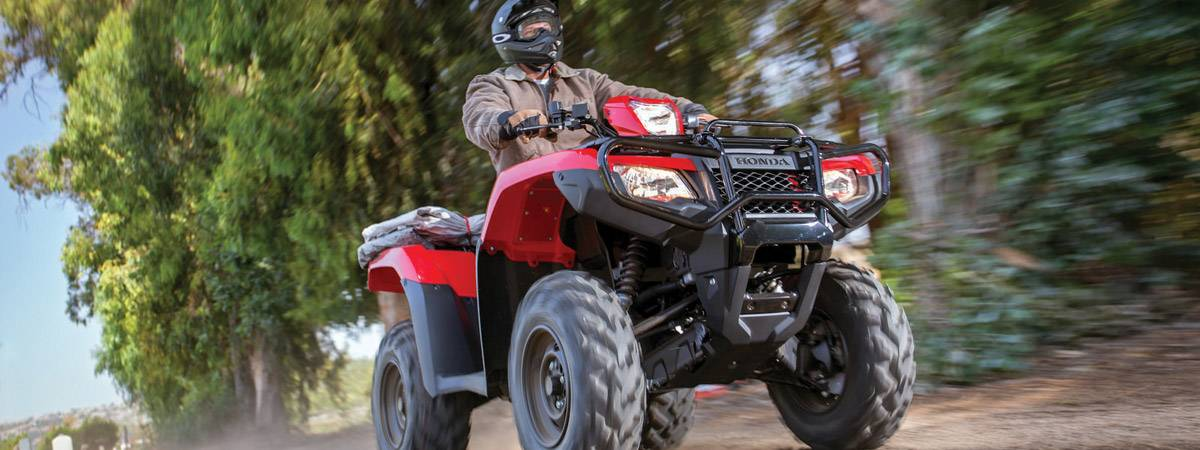 Man riding on Honda ATV